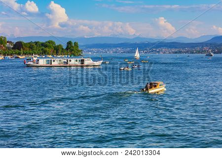 Zurich, Switzerland - May 11, 2018: Lake Zurich, summits of the Alps in the background, view from the city of Zurich. Lake Zurich is a lake in Switzerland, extending southeast of the city of Zurich, which is the largest city in the country.