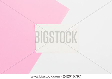Paper Vintage Envelope On White And Pink Background. Flat Lay. Top View