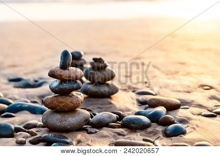 Pile Of Balanced Rocks On The Carlsbad State Beach At Sunset Time, California