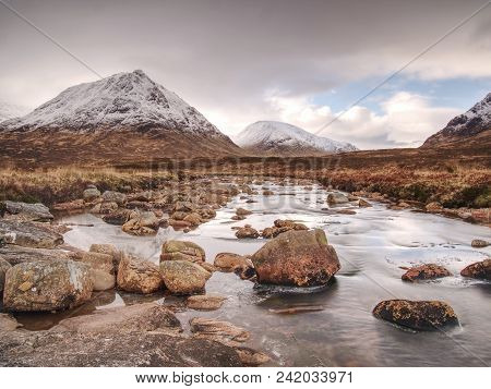 Cold Winter Day On Meadow At River Coupall At Delta To River Etive  Near Glencoe In The Scottish Hig