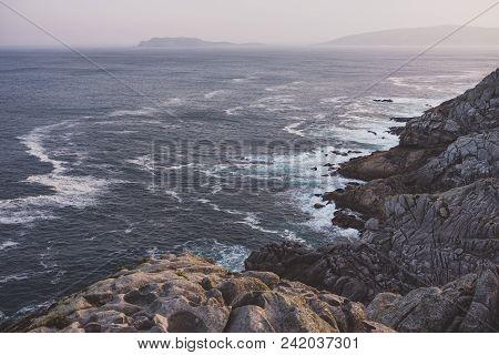 Summer Atlantic Ocean Rocky Coastline Panorama, Biscay Bay, Spain. Misty Sunset View.