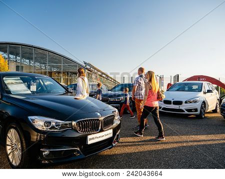 Paris, France - Oct 15, 2017: Group Of People Shopping For New Brand Cars In A Row Waiting For Their