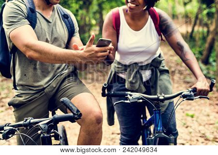 Group of friends out bicycling together