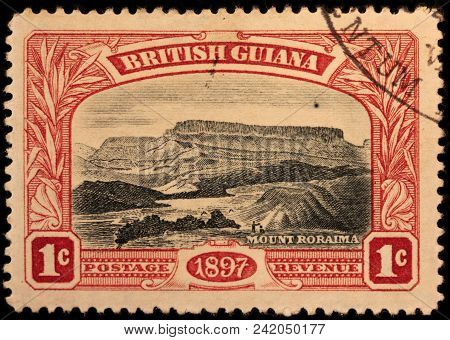 Luga, Russia - January 23, 2018: A Stamp Printed By British Guiana Shows Beautiful View Of Mount Ror