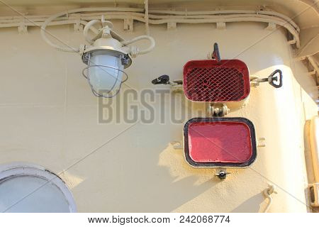 Old Vintage Lamp On Ship Deck Wall Industrial Ship Image. Bulkhead Light On Navy Ship Against Retro