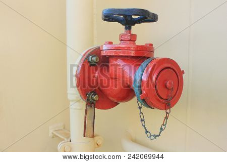 Sprinkler Valve Fire Caution Equipment Close Up View. Industrial Fire Fighting Object, Red Colored W