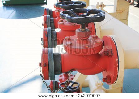 Industrial Fire Valve Sprinklers In Row Close Up View. Industrial Fire Fighting System, Red Water Su