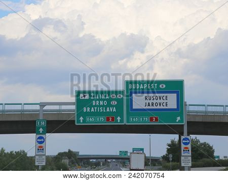 Signpost With Motorway Signs To Reach Budapest Or Bratislava