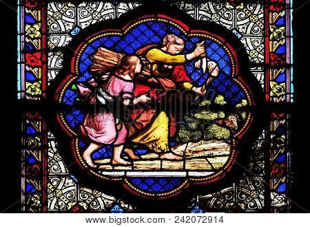 PARIS, FRANCE - JANUARY 05: Isaac carrying the wood of the sacrife, prefiguration of the carrying of the Cross, stained glass window in the Basilica of Saint Clotilde in Paris, on January 05, 2018.