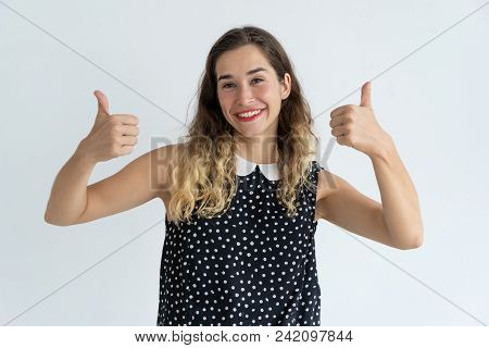 Smiling Pretty Young Woman Showing Thumbs Up And Looking At Camera. Recommendation Concept. Isolated