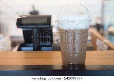 Ice Mocha With Milk Cream On Table In Coffee Shop