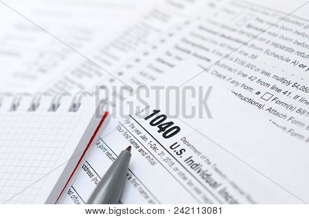 The Pen And Notebook Is Lies On The Tax Form 1040 U.s. Individual Income Tax Return. The Time To Pay