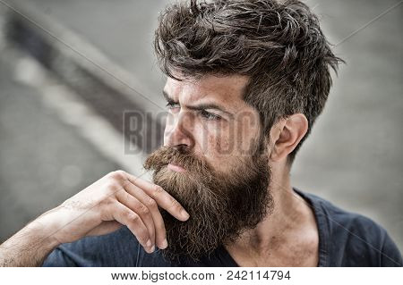 Man With Beard And Mustache Looks Thoughtful Or Troubled Bearded Man On Concentrated Face Touches Be