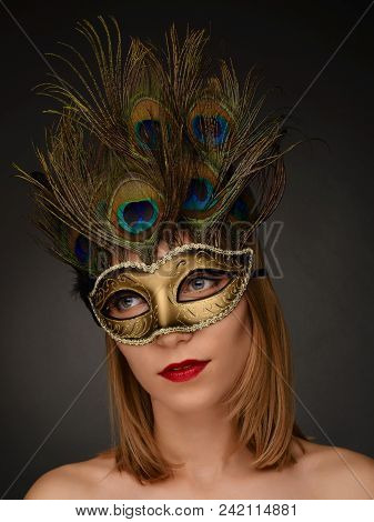 Close-up Portrait Of Beautiful Woman With Carnival Mask. Sexy Girl With Holiday Makeup And Red Lips.