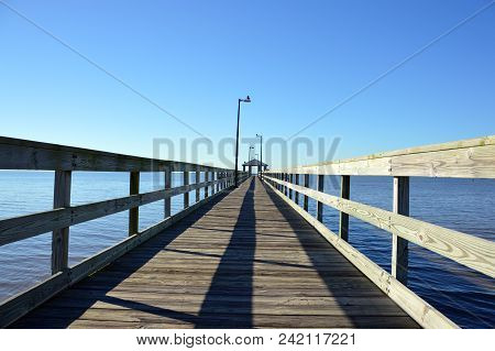 Wooden Pier Leading Into A Cloudless Sky (2)