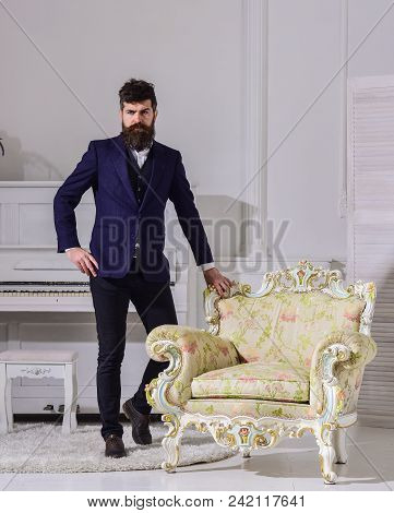 Fashion And Style Concept. Man With Beard And Mustache Wearing Classic Suit, Stylish Fashionable Out