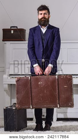 Man, Traveller With Beard And Mustache With Luggage, Luxury White Interior Background. Baggage Deliv