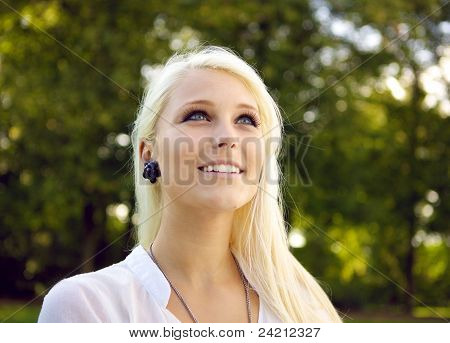 Beautiful Woman With Dark Trees In Background