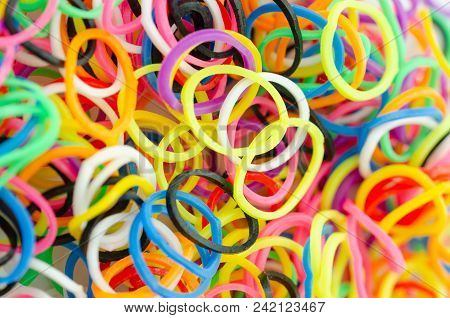 Various Colorful Plastic Tires Are On The Table . Selective Clarity,