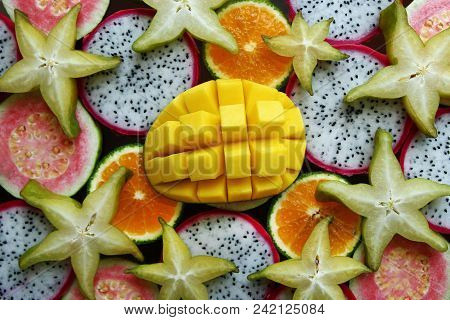 Top View On The Mixed Fresh And Ripe Tropical Fruits (mango, Tangerine, Guava, Dragon Fruit, Star Fr