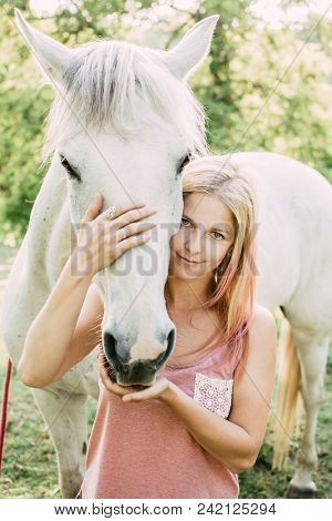 Horse rider woman with white horse