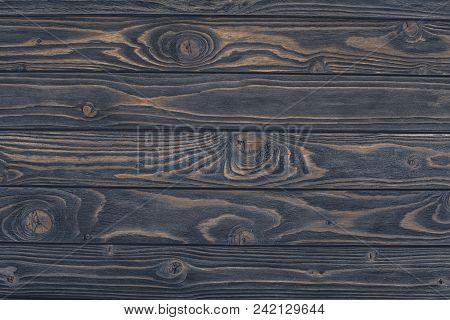 Top View Of Dark Grunge Wooden Background