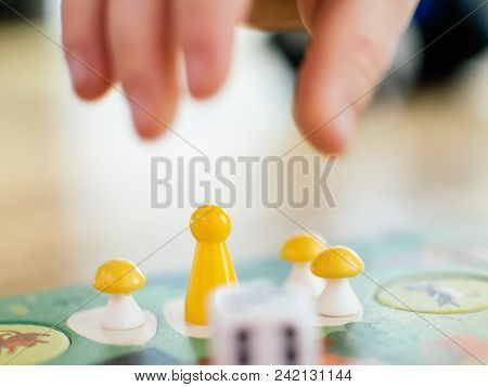 Board Game Baby Hand Stretches To Take The Game Chip To Make Your Move