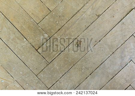 A Close-up Of An Old Gray Faded Parquet Covered With Dust And Dirt. Result Of Repair. Cleaning And C