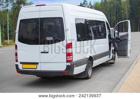 Minibus With An Open Door At The Bus Stop