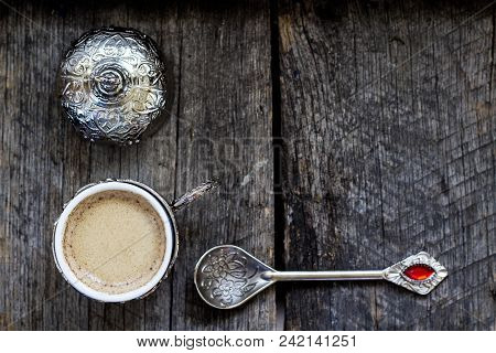 Turkish Coffee In A Traditional Cup And Teaspoon On A Wooden Background