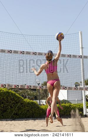 Ostia, Italy. May 12, 2015: Woman Hit The Ball Jumping During A Beachvolley Match Between Friends On