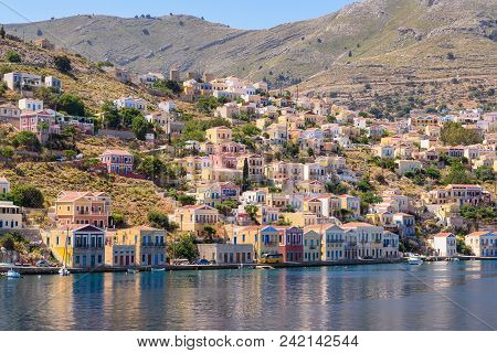 Colorful Houses On The Hillside Of The Island Of Symi. Greece