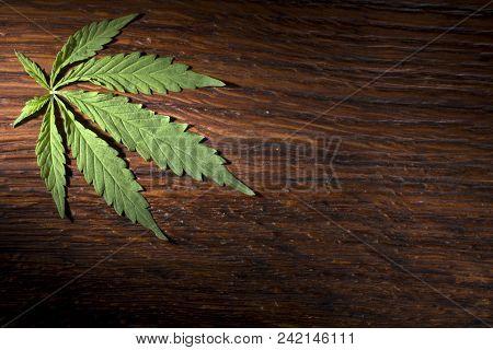 A Hemp Sheet On A Brown Wooden Background Close Up