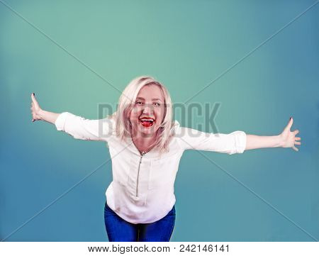 Attractive Mature Woman Relax And Dance On Copy Space. Portrait Of Happy Girl Imitating A Flight For