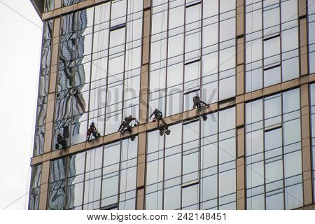 Moscow, Russia - May, 18, 2018: Steeplejacks work on a wall of Moscow city building