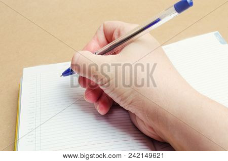 A Female Hand Writes In A Notebook And Makes Notes, Plans For The Day, Shopping List, Close-up, Busi