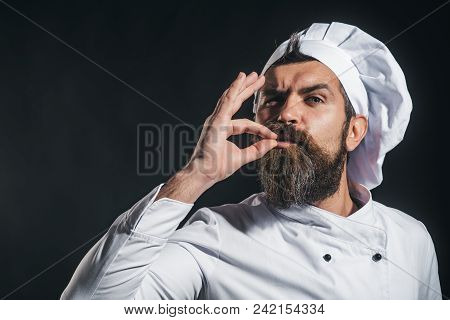 Serious Bearded Chef, Cook Or Baker Gesturing Excellent. Male Chef In White Uniform With Perfect Sig