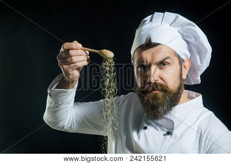 Adding Seasoning. Portrait Of Bearded Male Chef Sprinkling Spices. Hand Sprinkling Spices. Cooking.