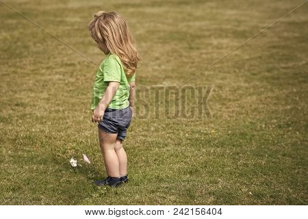 Child Childhood Children Happiness Concept. Boy Small Cute Kid With Blond Long Hair In Green Shirt A