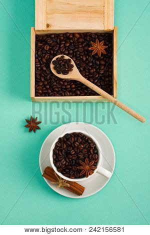 Wooden Box And Spoon With Coffee Seeds, сup Of Coffee Beans Spice Cinnamon, Anis On Cyan    Backgrou