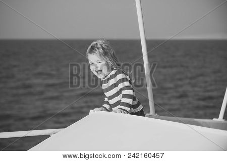 Child Childhood Children Happiness Concept. Kid In Striped Blue And White Shirt On Boat. Childhood A