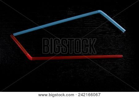 Straws For Cocktails On A Black Wooden Background