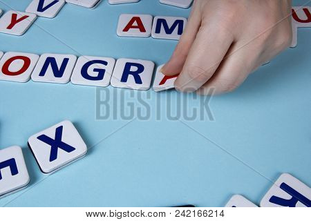 Female Hands Spread Letters On A Blue Background