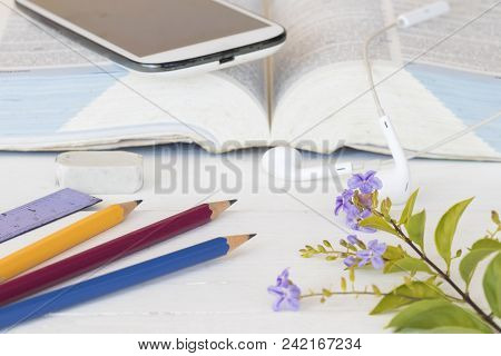Mobile Phone With Dictionary Book For Study Of Student On Table White