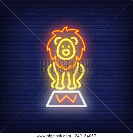 Circus Lion Neon Icon. Trained Wild Animal On Stand On Dark Brick Wall Background. Night Bright Adve