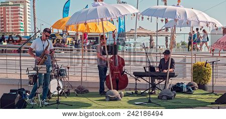 Malaga, Spain - May 18, 2018. Band Of Musicians Performing Live In Walk Muelle Uno, Malaga, Spain