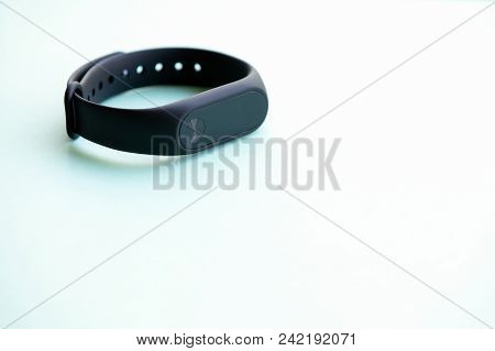 Fitness Tracker Or Smartwatch On Table With Copy Space.