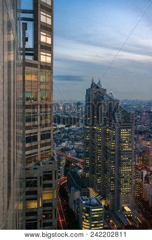 Tokyo, Japan - November 17: Tourists Watch Shinjuku Skyline At Sunset With Park Hyatt Hotel Skyscrap