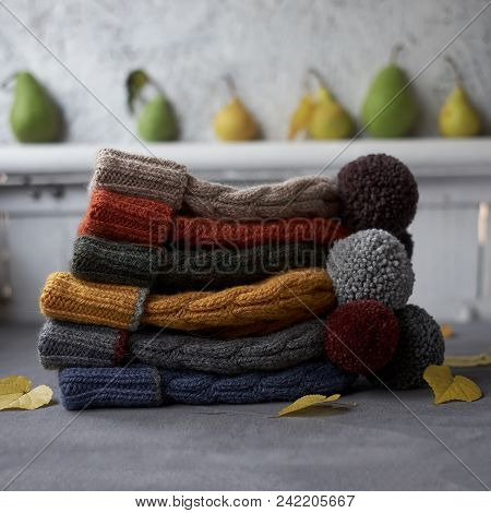 Many Colorful Hats On A Gray Concrete Background
