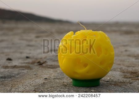 Large Handmade Candles On The Sea Background